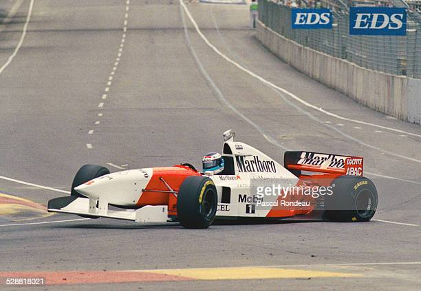 Mika Hakkinen of Finland suffers a left rear puncture leading to a serious accident as he drives the Marlboro McLaren Mercedes McLaren MP410 Mercedes...