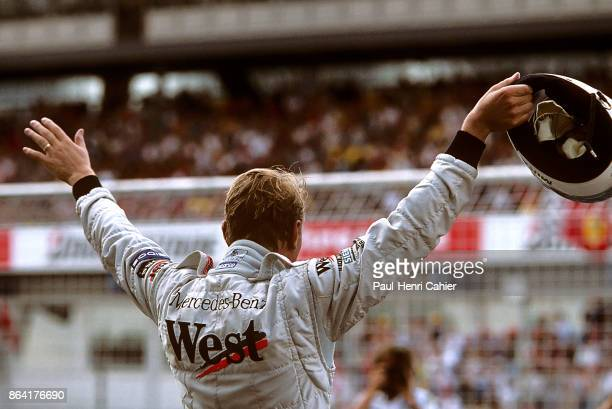 Mika Häkkinen Grand Prix of Germany Hockenheimring 01 August 1999 Mika Häkkinen celebrates his pole position and waves at the crowd in the 1999 Grand...