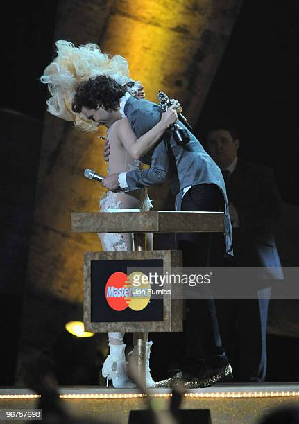 Mika hugs Lady Gaga after she won the award for best International Album at The Brit Awards 2010 at Earls Court on February 16 2010 in London England