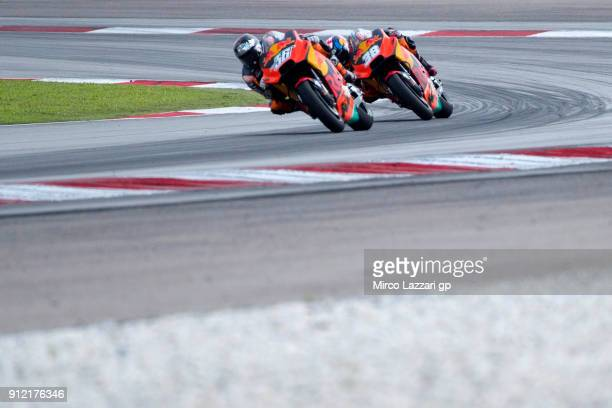 Mika Kallio of Finland and Red Bull KTM Factory Racing leads Bradley Smith of Great Britain and Red Bull KTM Factory Racing during the MotoGP test in...