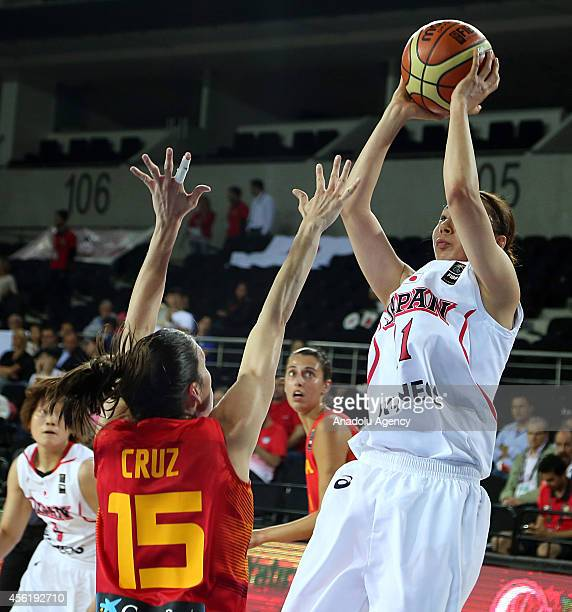 Mika Kurihara of Japan in action against Anna Cruz of Spain during the 2014 FIBA World Championship For Women Group A basketball match between Japan...