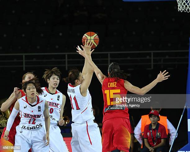 Mika Kurihara of Japan in action against Anna Kruz of Spain during the 2014 FIBA World Championship For Women Group A basketball match between Japan...