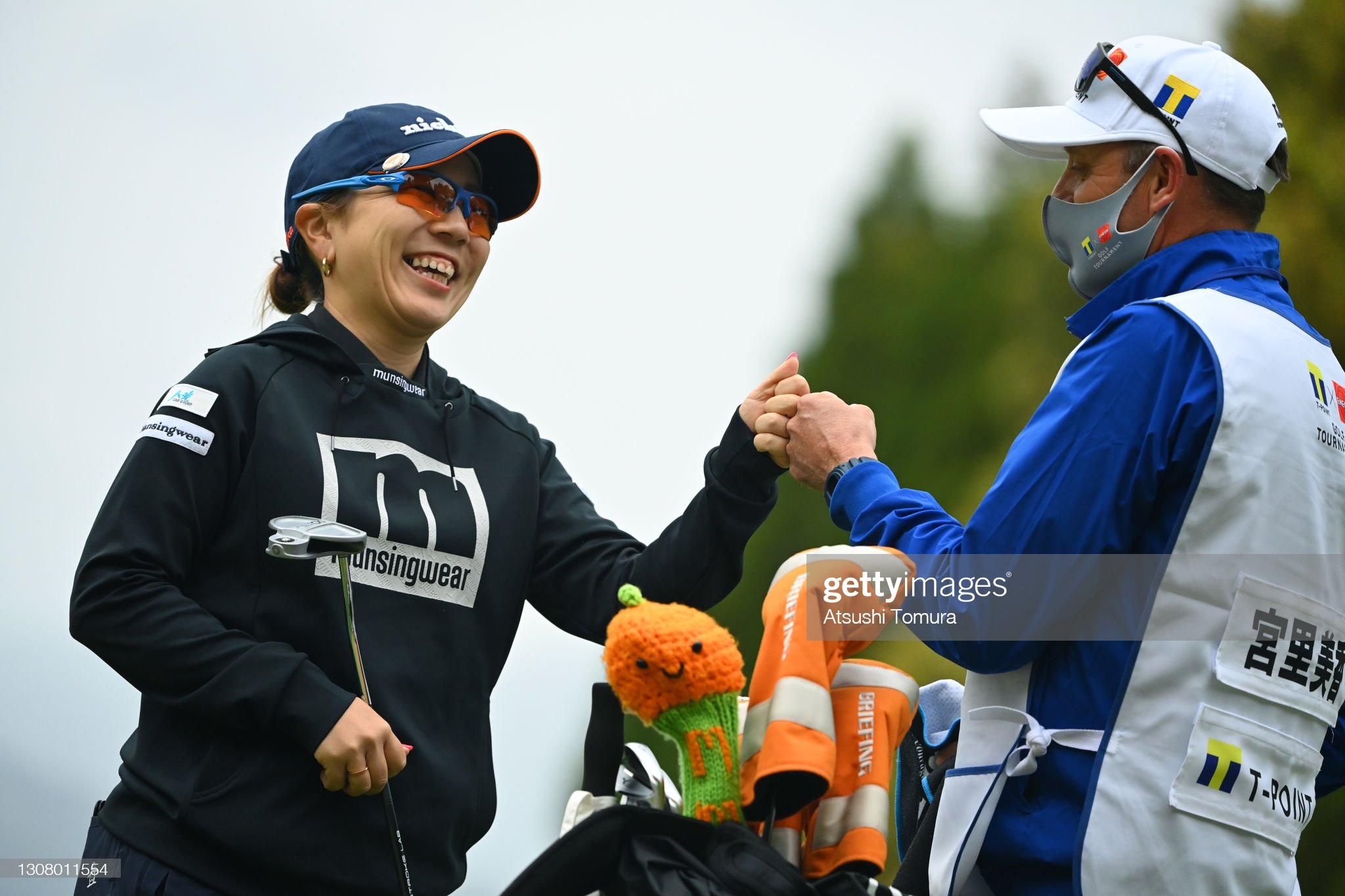 https://media.gettyimages.com/photos/mika-miyazato-of-japan-fist-bumps-with-her-caddie-after-the-birdie-on-picture-id1308011554?s=2048x2048