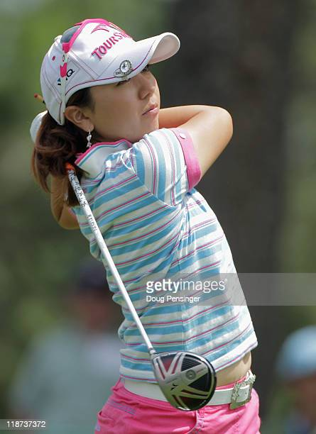 Mika Miyazato of Japan follows through on her tee shot on the 11th hole during the continuation of the third round of the US Women's Open at The...