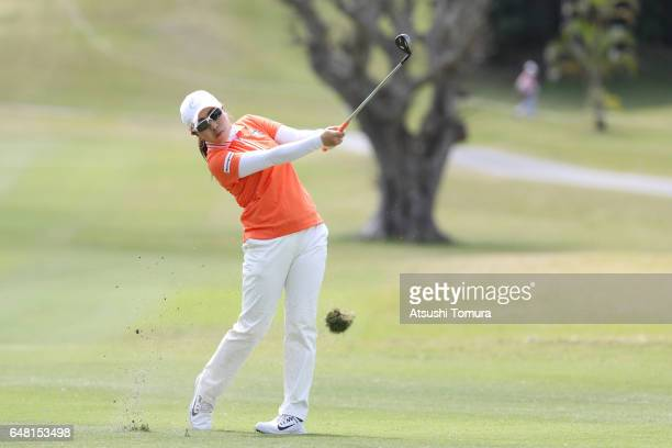 Mika Miyazato of Japan hits her second shot on the 12th hole during the final round of the Daikin Orchid Ladies Golf Tournament at the Ryukyu Golf...
