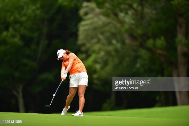 Mika Miyazato of Japan hits her third shot on the 8th hole during the final round of the Earth Mondamin Cup at the Camellia Hills Country Club on...