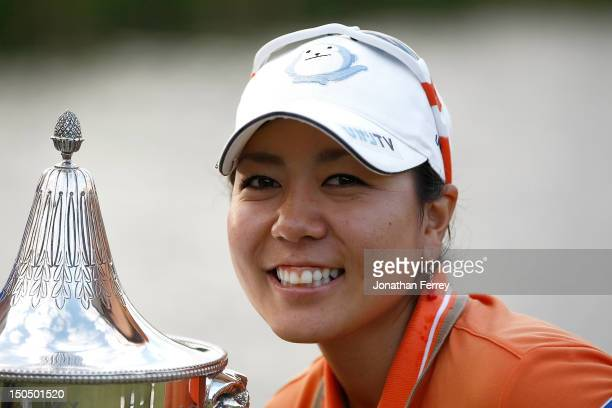 Mika Miyazato of Japan poses with the trophy on the 18th hole after her 13 under par victory during the final round of the Safeway Classic at Pumpkin...