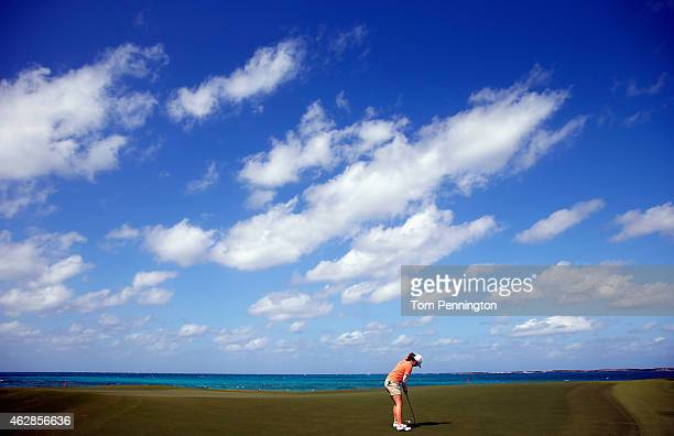 Mika Miyazato of Japan putts the ball on the eighth green during round two of the Pure Silk Bahamas LPGA Classic at the Ocean Club course on February...