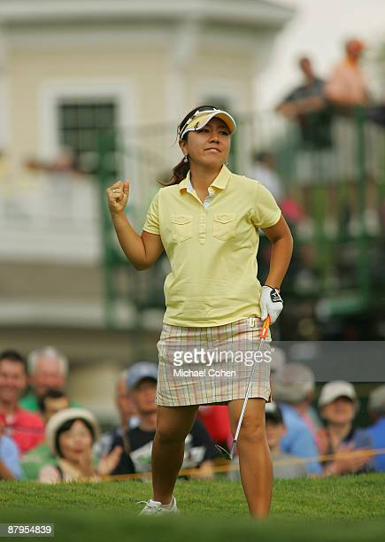 Mika Miyazato of Japan reacts to her chip in birdie on the ninth hole during the fourth round of the LPGA Corning Classic at the Corning Country Club...