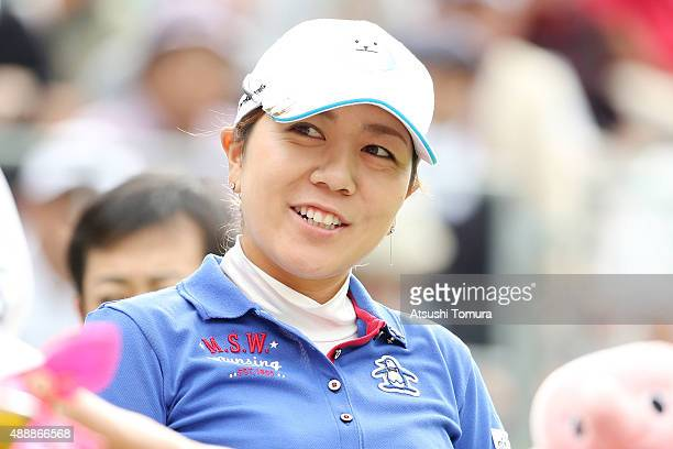 Mika Miyazato of Japan smiles during the first round of the Munsingwear Ladies Tokai Classic at the Shin Minami Aichi Country Club Mihama Course on...