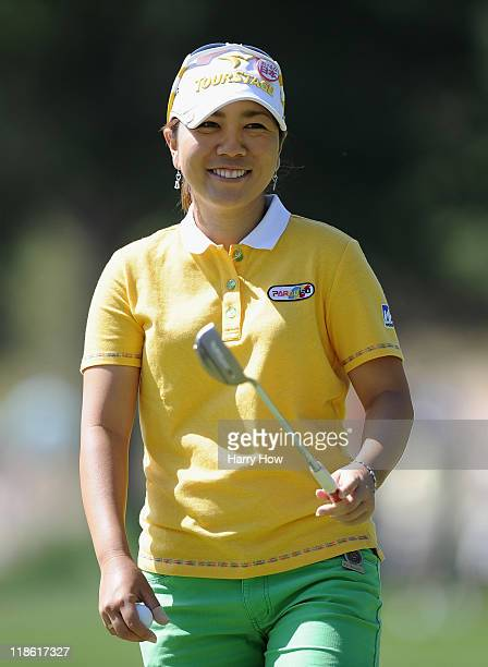 Mika Miyazato of Japan smiles to a birdie by playing partner Sandra Gal of Germany on the 10th green during the continuation of the second round of...