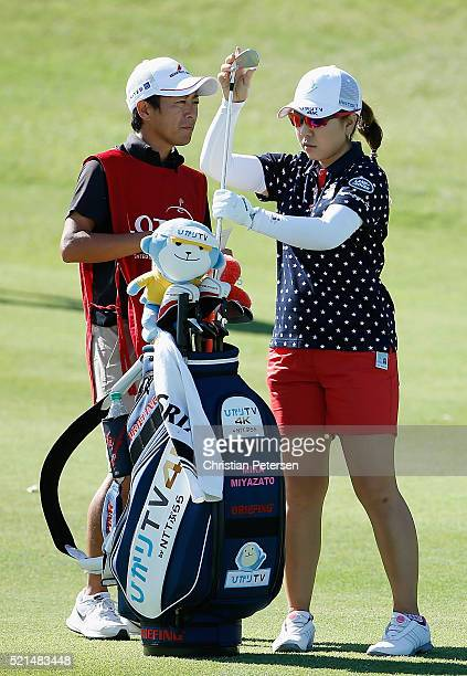 Mika Miyazato of Japan takes a club from her caddie and bag on the fifth hole during the third round of the LPGA LOTTE Championship Presented By...