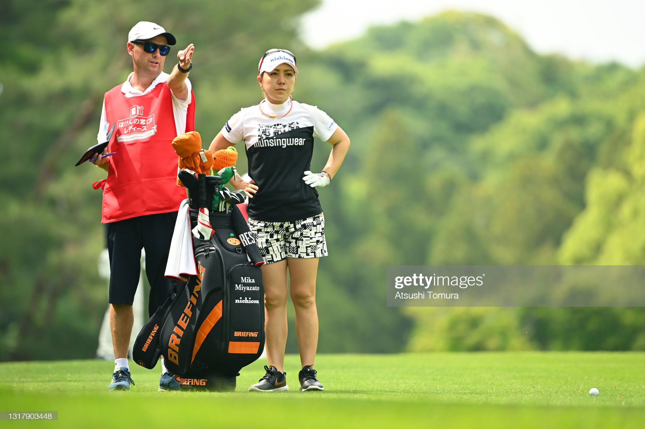 https://media.gettyimages.com/photos/mika-miyazato-of-japan-talks-with-her-caddie-before-her-second-shot-picture-id1317903448?s=2048x2048
