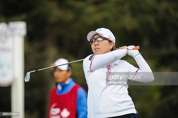 Mika Miyazato of Japan tees off on the 15th hole during the first round of the Canadian Pacific Women's Open at Priddis Greens Golf and Country Club...