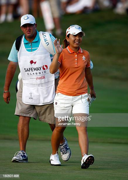 Mika Miyazato of Japan walks up the 18th hole during the final round of the Safeway Classic at Pumpkin Ridge Golf Club on August 19 2012 in North...