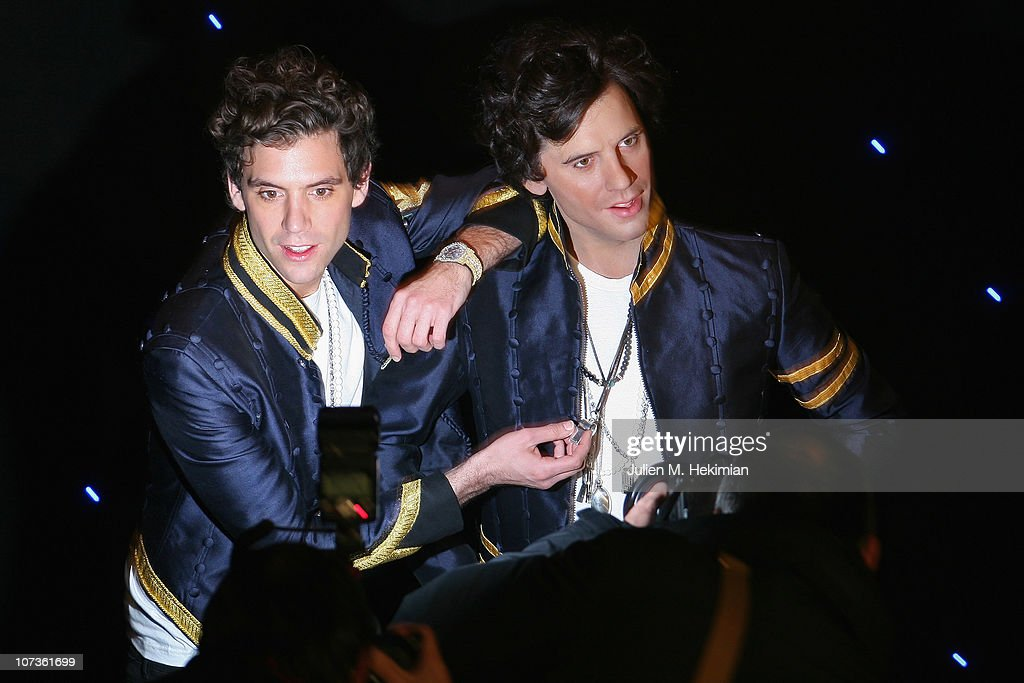 Mika poses with his waxwork at Musee Grevin on December 6, 2010 in Paris, France.