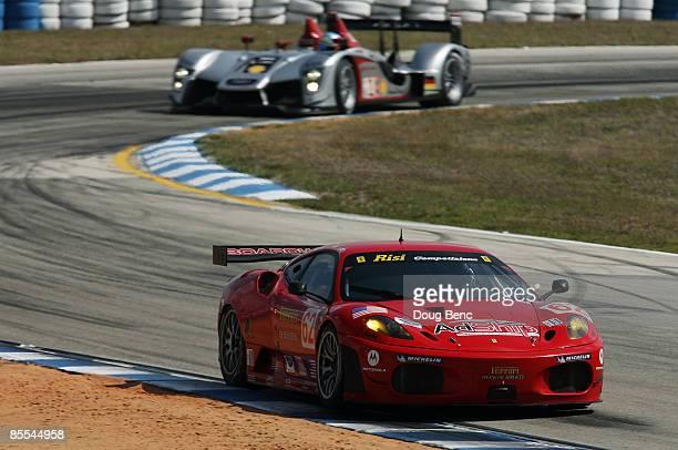 Mika Salo driver of the Risi Competizione Ferrari 430 GT leads Mike Rockenfeller driver of the Audi Sport North America Audi R15 out of turn five...
