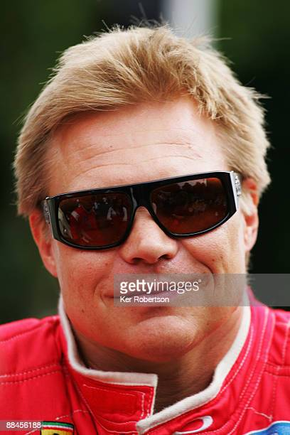 Mika Salo of Finland and Risi Competizione is seen at the drivers parade during previews for the 77th running of the Le Mans 24 Hour race on June 12...