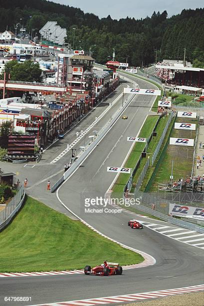 Mika Salo of Finland drives the Scuderia Ferrari Marlboro Ferrari F399 Ferrari V10 ahead of his team mate Eddie Irvine during the Belgian Grand Prix...