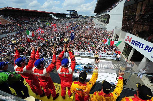 Mika Salo of Finland Jaime Melo of Brazil and Pierre Kaffer of Germany celebrating their GT2 class victory for the Risi Competizione Ferrari 430 GT...