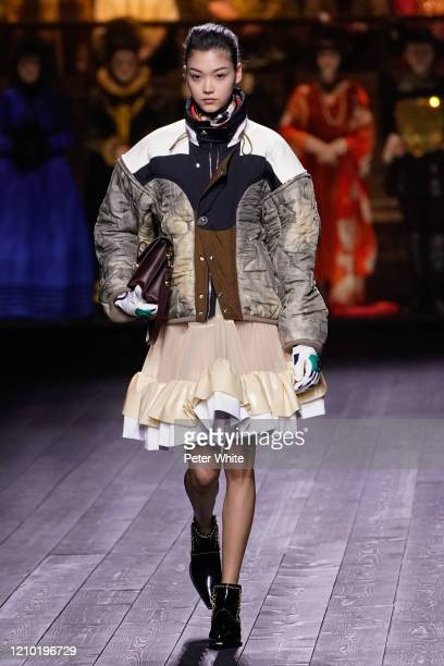 Mika Schneiderwalks the runway during the Louis Vuitton as part of the Paris Fashion Week Womenswear Fall/Winter 2020/2021 on March 03, 2020 in...