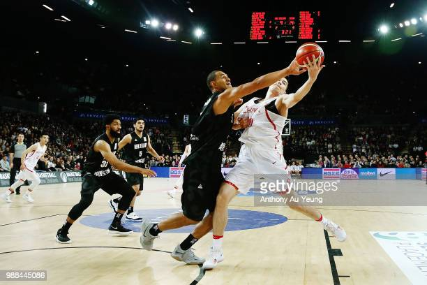 Mika Vukona of New Zealand competes against Abudushalamu Abudurexiti of China during the FIBA World Cup Qualifying match between the New Zealand Tall...