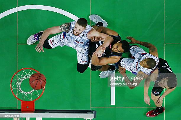 Mika Vukona of New Zealand competes against Eric Jacobsen of Adelaide during the round four NBL match between the New Zealand Breakers and the...