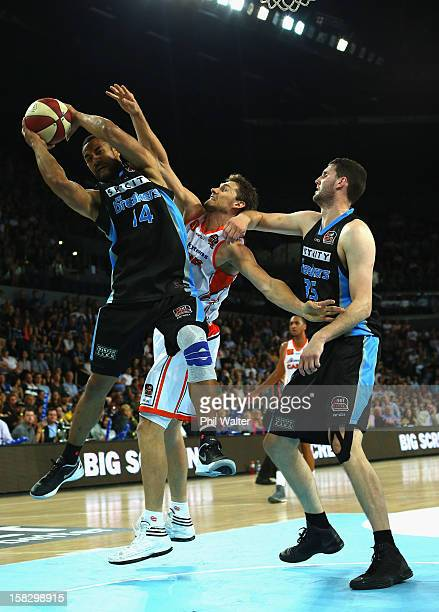 Mika Vukona of the Breakers and Alex Loughton of the Taipans compete for the ball during the round 11 NBL match between the New Zealand Breakers and...