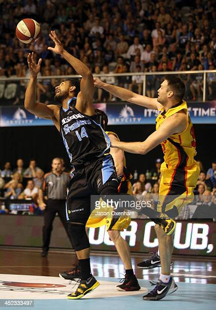 Mika Vukona of the Breakers and Mark Worthington of the Melbourne Tigers battle for a rebound during the round eight NBL match between the New...