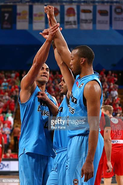 Mika Vukona of the Breakers celebrates wining in overtime with Corey Webster and Akil Mitchell of the Breakers during the round six NBL match between...