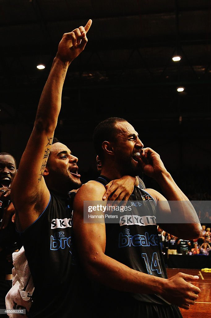 Mika Vukona of the Breakers celebrates with Corey Webster of the Breakers after winning game two of the NBL Grand Final series between the New Zealand Breakers and the Cairns Taipans at North Shore Events Centre on March 8, 2015 in Auckland, New Zealand.