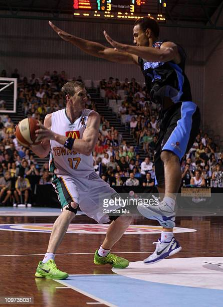 Mika Vukona of the Breakers defends Peter Crawford of the crocs during the round 21 NBL match between the New Zealand Breakers and the Townsville...