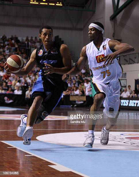 Mika Vukona of the Breakers dribbles past Rosell Ellis of the Crocs during the round 21 NBL match between the New Zealand Breakers and the Townsville...