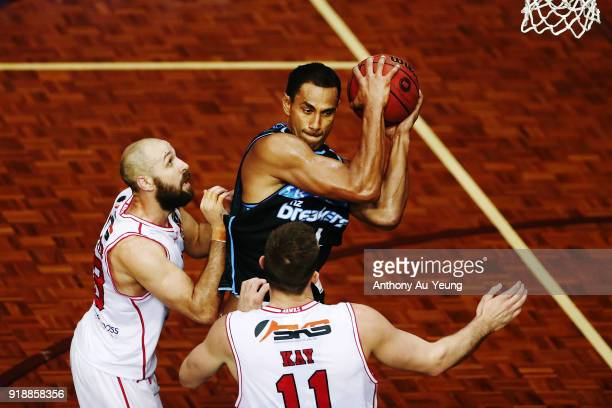 Mika Vukona of the Breakers grabs a rebound against Rhys Martin and Nick Kay of the Hawks during the round 19 NBL match between the New Zealand...