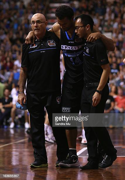Mika Vukona of the Breakers is helped off the court during the round 23 NBL match between the New Zealand Breakers and the Melbourne Tigers at the...