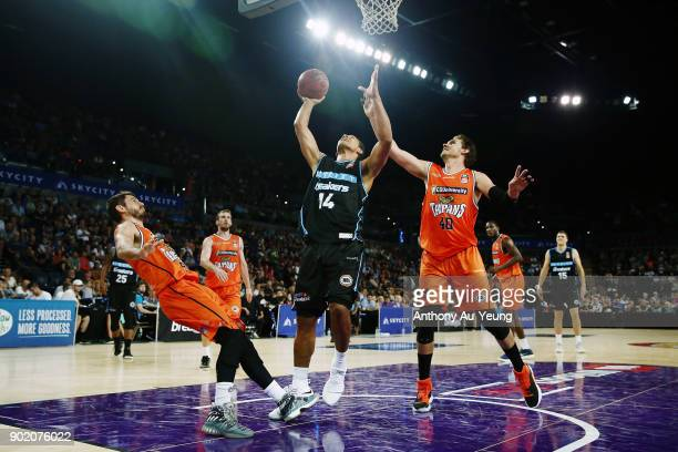 Mika Vukona of the Breakers puts up a shot against Alex Loughton and Jarrad Weeks of the Taipans during the round 13 NBL match between the New...