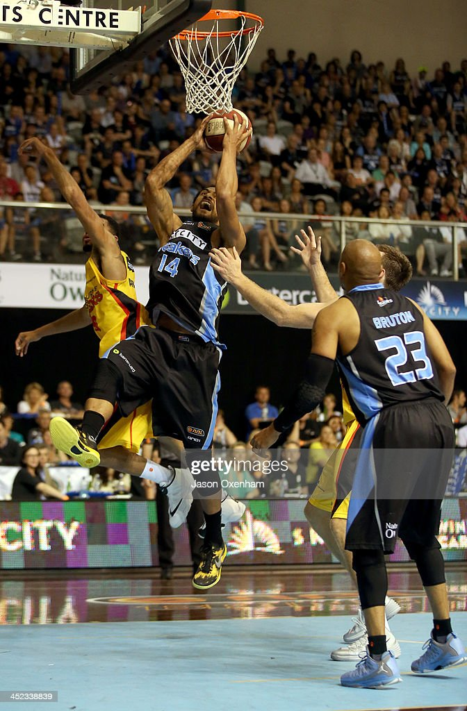 Mika Vukona of the Breakers secures a rebound during the round eight NBL match between the New Zealand Breakers and the Melbourne Tigers at North Shore Events Centre on November 28, 2013 in Auckland, New Zealand.