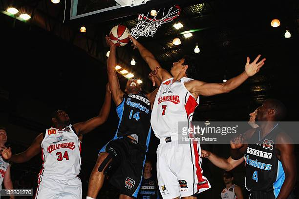 Mika Vukona of the Breakers takes the ball up to the net as Oscar Forman of the Hawks defends during the round six NBL match between the New Zealand...