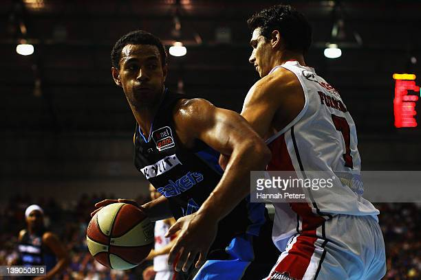 Mika Vukona of the Breakers tries to get past Oscar Forman of the Hawks during the round 20 NBL match between the New Zealand Breakers and the...