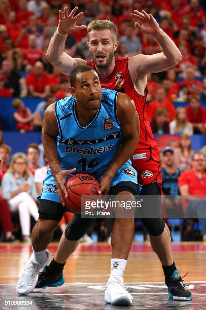 Mika Vukona of the Breakers works to the basket against Jesse Wagstaff of the Wildcats during the round 16 NBL match between the Perth Wildcats and...