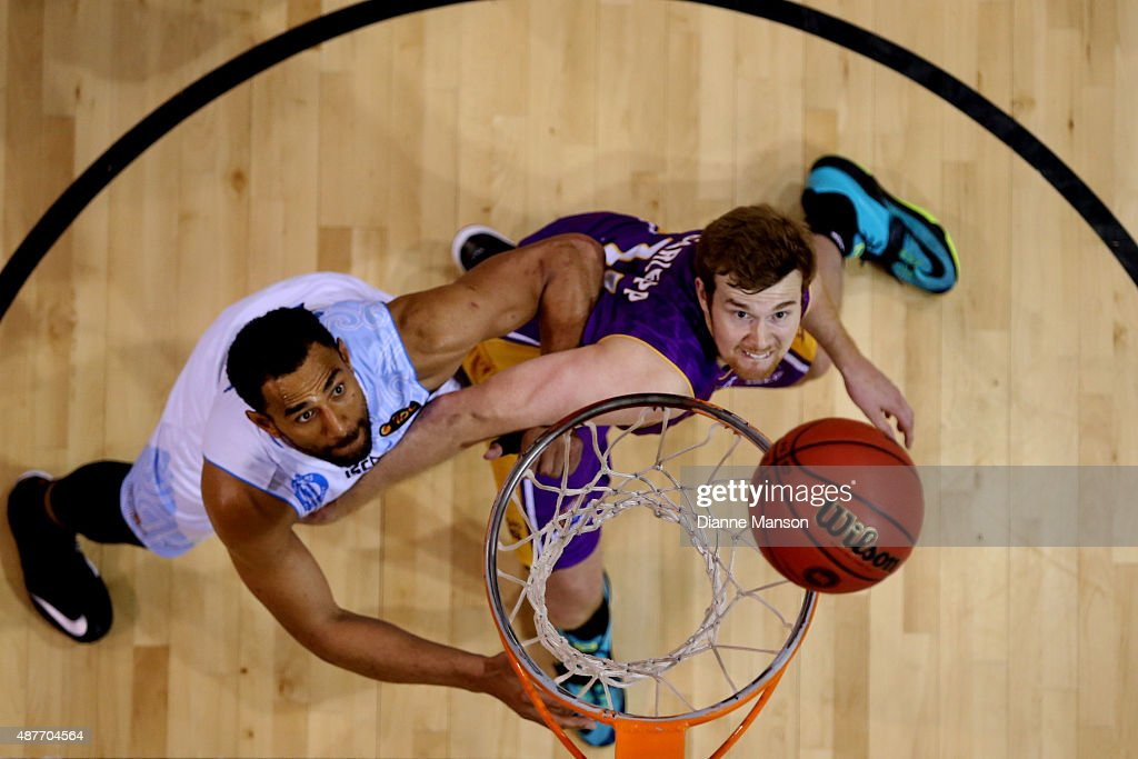 Mika Vukona (L) of the New Zealand Breakers and Thomas Garlepp of the Sydney Kings compete for the rebound during the NBL pre-season match between the New Zealand Breakers and the Sydney Kings at Stadium Southland on September 11, 2015 in Invercargill, New Zealand.