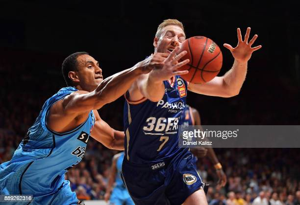 Mika Vukona of the New Zealand Breakers competes for the ball with Brendan Teys of the Adelaide 36ers during the round nine NBL match between the...