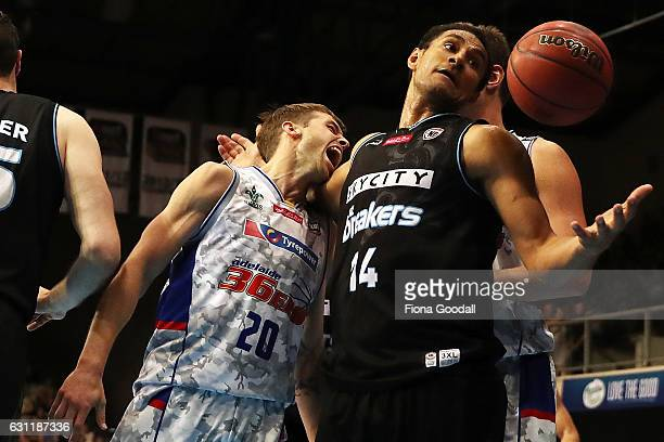 Mika Vukona of the NZ Breakers takes a rebound from Nathan Sobey of the Adelaide 36ers during the round 14 NBL match between the New Zealand Breakers...