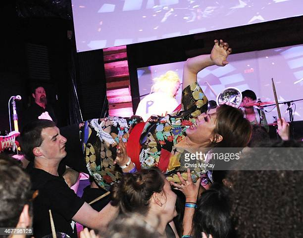 Mika Yoshimura of BoPeep crowd surfs during PeelanderZ's performance at Live Wire on March 26 2015 in Athens Georgia