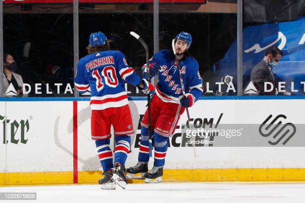 Mika Zibanejad and Artemi Panarin of the New York Rangers celebrate after scoring a goal in the second period against the Washington Capitals at...