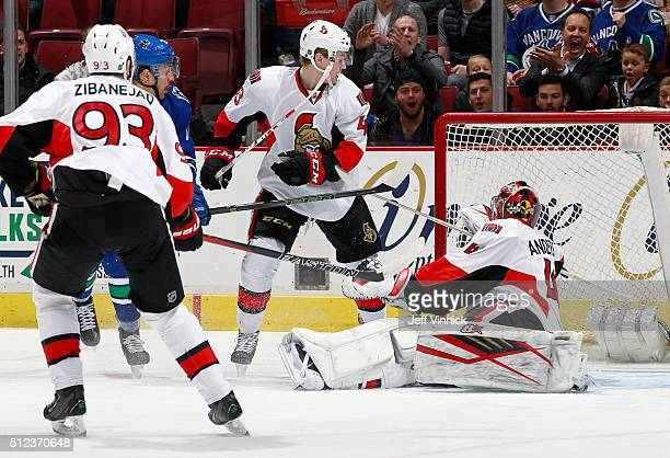 Mika Zibanejad and Ryan Dzingel of the Ottawa Senators watch as Emerson Etem of the Vancouver Canucks scores on Craig Anderson of the Ottawa Senators...