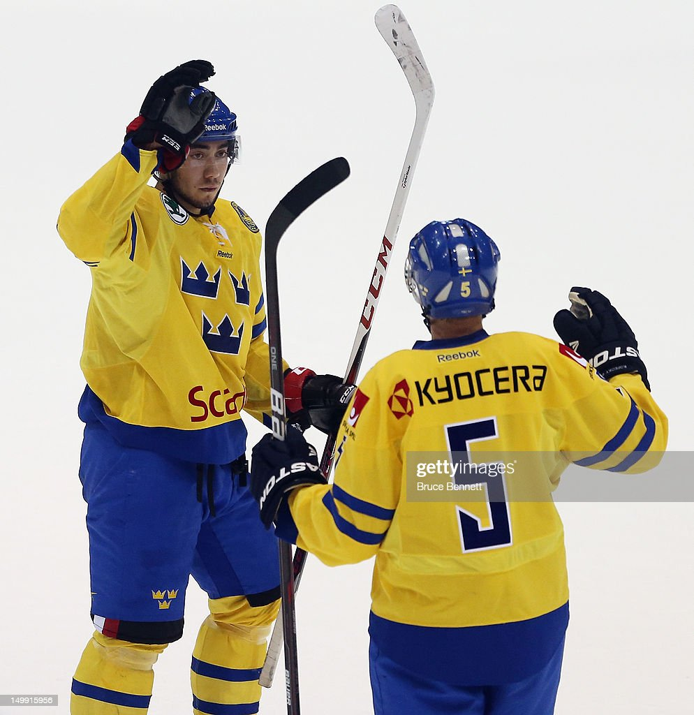 Mika Zibanejad #20 of Team Sweden celebrates his goal at 19:47 of the first period along with Rasmus Bengtsson #5 in their game against the USA White Squad at the USA hockey junior evaluation camp at the Lake Placid Olympic Center on August 6, 2012 in Lake Placid, New York.