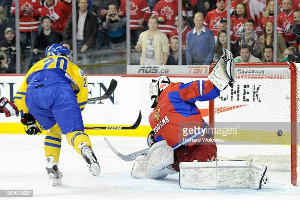 Mika Zibanejad of Team Sweden shoots the puck past Andrei Makarov of Team Russia to win during the 2012 World Junior Hockey Championship Gold Medal...