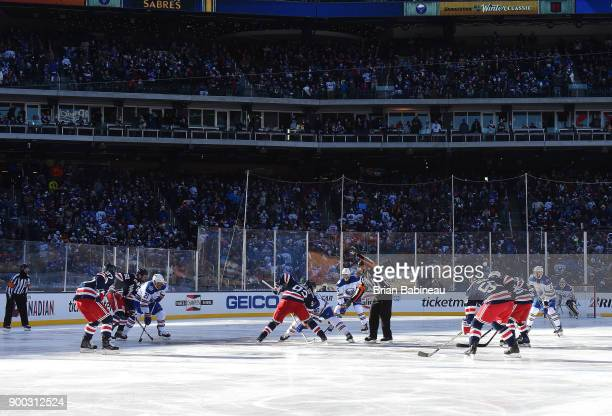 Mika Zibanejad of the New York Rangers and Ryan O'Reilly of the Buffalo Sabres take the center ice faceoff in the first period of the 2018...