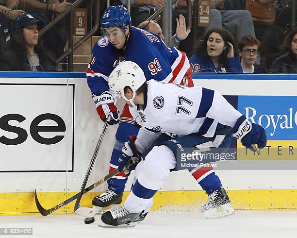 Mika Zibanejad of the New York Rangers and Victor Hedman of the Tampa Bay Lightning fight for control of the puck during the second period at Madison...